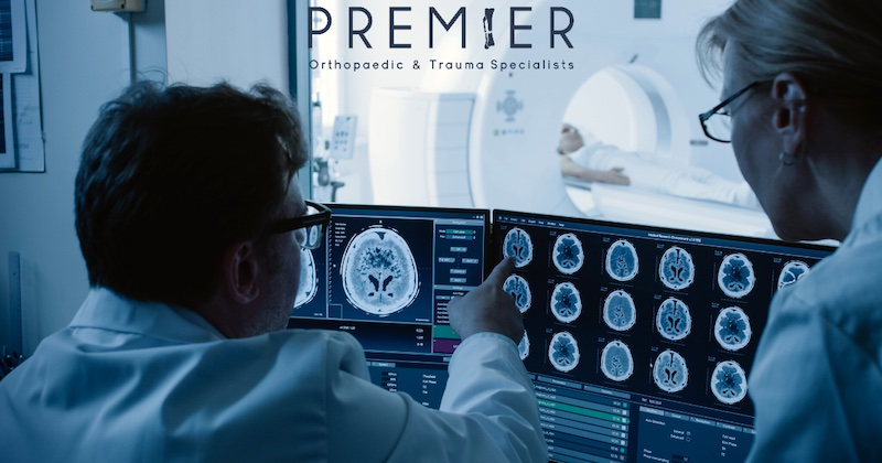 Two Doctors looking at imaging reports