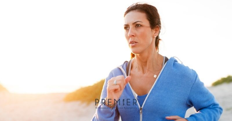 Woman runs for her bone health as recommended by Premier Orthopaedic & Trauma Specialists